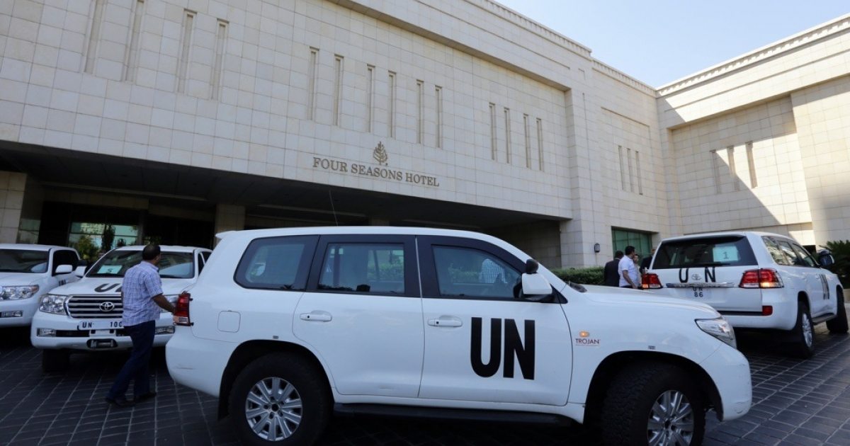 The UN chemical weapons investigation team arrives in Damascus on August 18, 2013.</p>