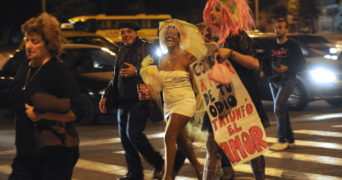 Homosexuals celebrate after Uruguayan lawmakers approved the same-sex marriage bill on April 10, 2013.</p>