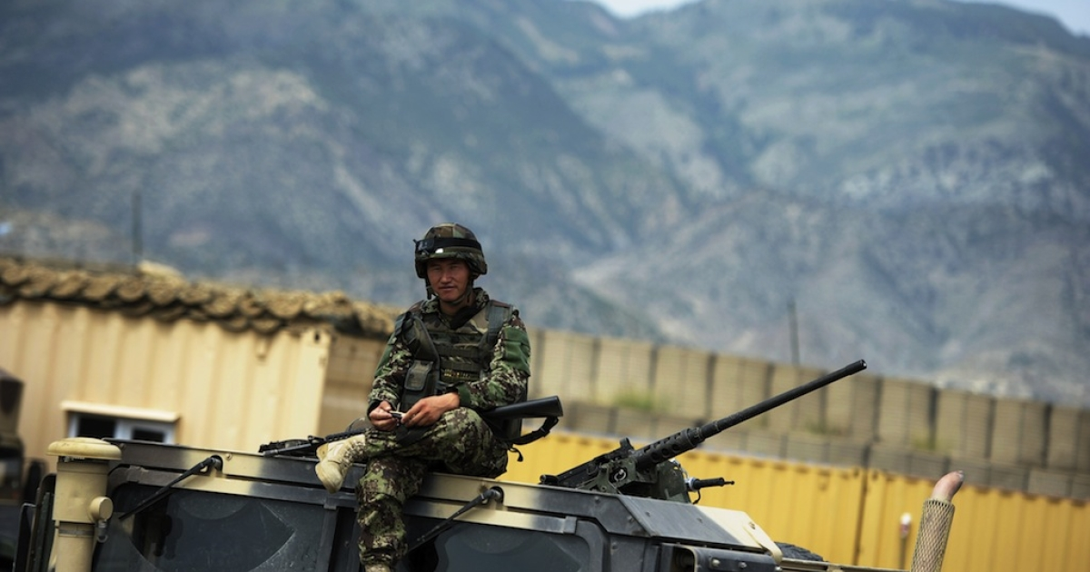 A soldier of the 2nd Kandak 1st brigade 203 corp of the Afghan National Army (ANA) sits on top of a military vehicle at their base in Narizah in the Khost Province on Aug. 14, 2012.</p>
