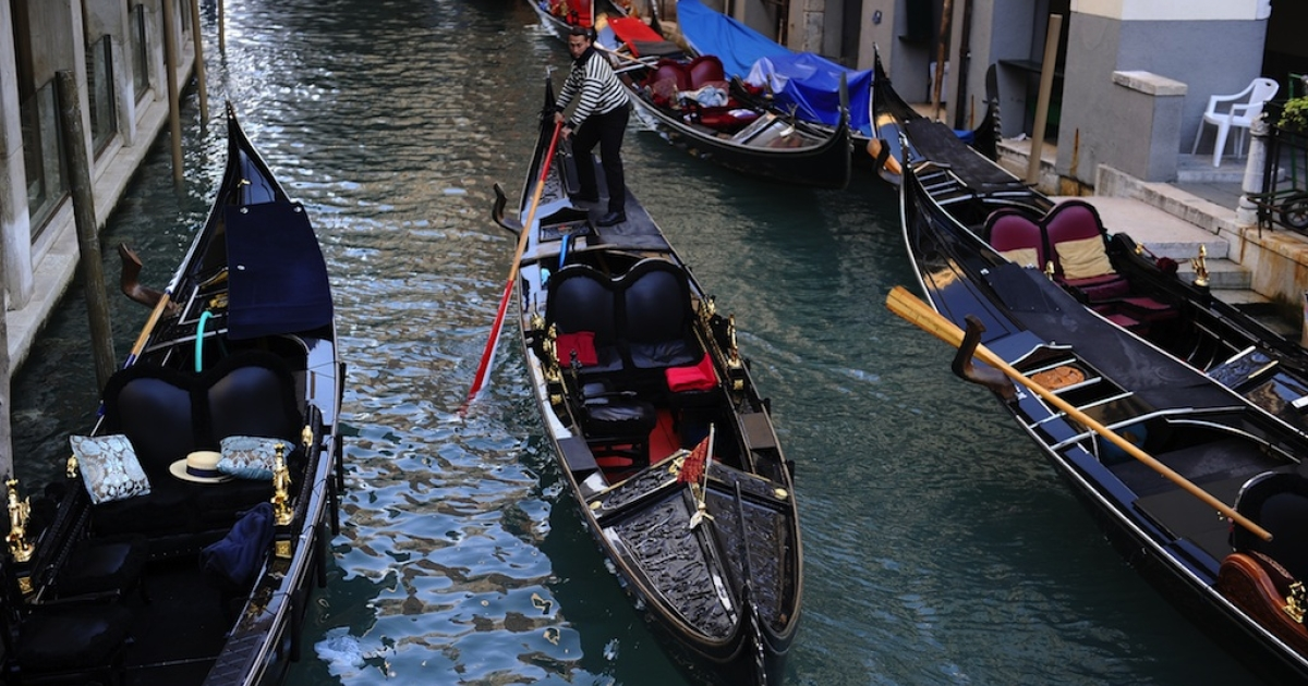 A gondola passes on a canal in Venice on April 12, 2012.</p>