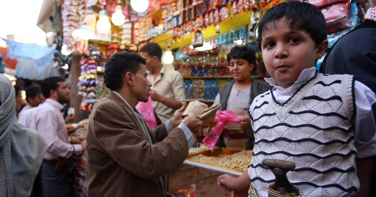Yemenis shop at a bazaar ahead of the upcoming Muslim Eid al-Fitr in Sanaa, on August 13, 2012. Muslims throughout the world prepare to celebrate the Eid al-Fitr festival at the end of the holy fasting month of Ramadan, in which they refrain from eating, drinking, smoking and sexual activities from dawn to dusk.</p>