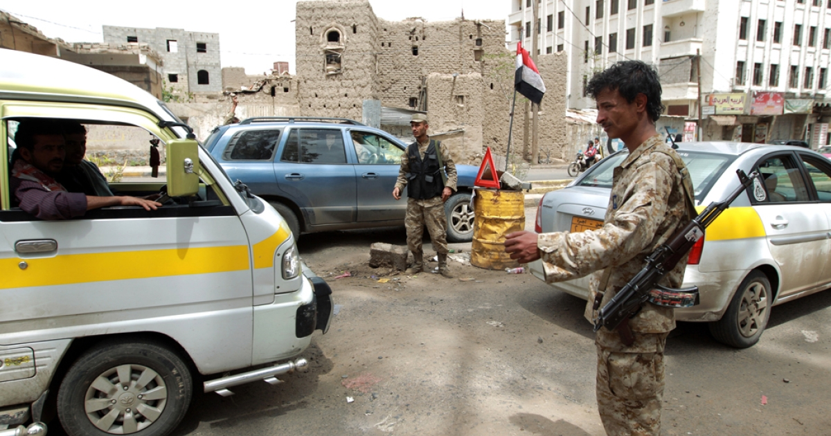 Yemeni police man a check point in Yemen's capital Saana, where the United States, Britain, France and Germany shut their diplomatic missions on security concerns on Aug. 3.</p>