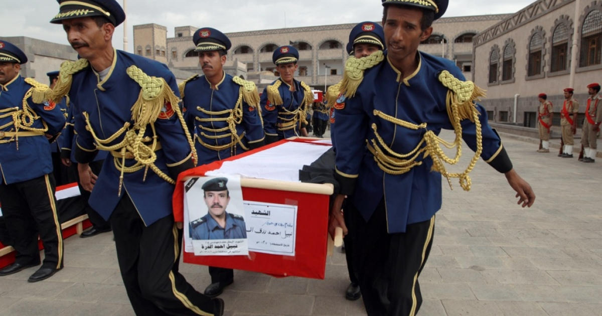 Honor guard soldiers carry the coffins of military officers during their funeral ceremony on Aug. 7, 2013 in the Yemeni capital Sanaa. Yemeni tribesmen shot down an army helicopter, killing eight soldiers, on August 6 in the lawless eastern province of Marib during a clash over repairs to a main oil pipeline blown up by saboteurs, a tribal chief said.</p>
