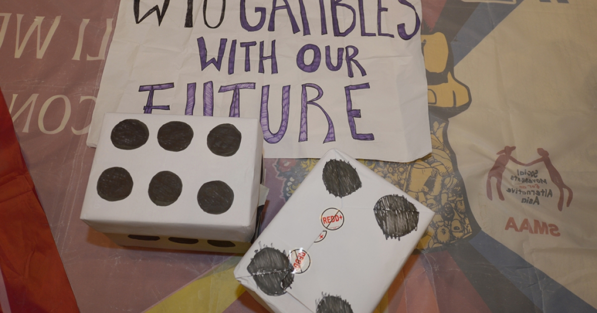 Fake dice are placed by activists from La Via Campesina while they hold a protest against the WTO at the 9th World Trade Organization (WTO) Ministerial Conference in Bali.</p>