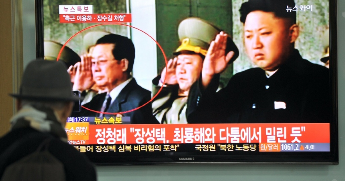 South Korean TV reports on the dismissal of Jang Song Thaek (circled), the uncle of North Korean leader Kim Jong Un. North Korean state media confirmed his arrest on December 9, 2013, accusing him of