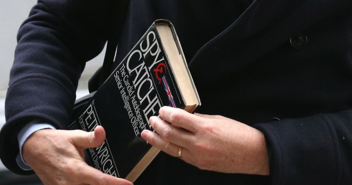 Alan Rusbridger, the Editor of the Guardian newspaper, carries a copy of Peter Wright's book 'Spycatcher' as he arrives at Portcullis House to face questions from the Home Affairs Committee on December 3, 2013 in London, England.</p>