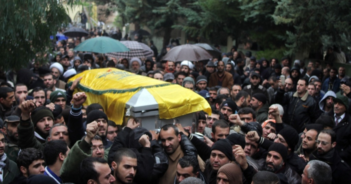 Mourners carry the coffin of Hassan Laqis, one of Hezbollah's top commanders, during his funeral in the eastern Lebanese city of Baalbek on Dec. 4, 2013.</p>