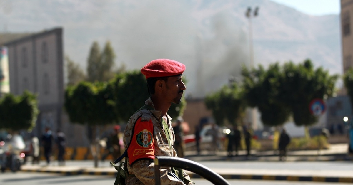 A Yemeni soldier patrols a street after a suicide car bombing at the defence ministry in the Yemeni capital Sanaa on December 5, 2013.</p>