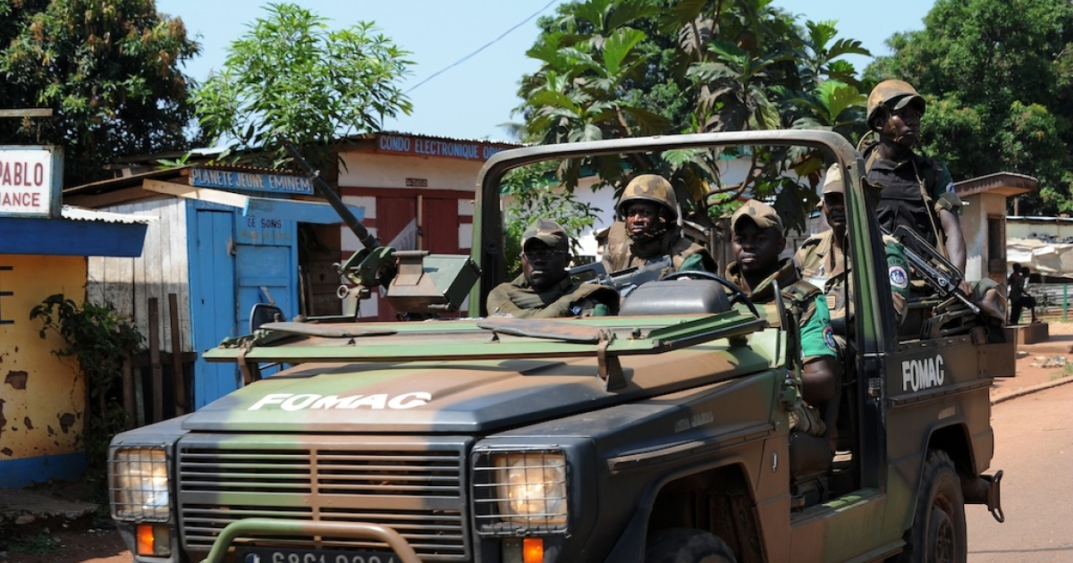 Soldiers of the African-led International Support Mission to the Central African Republic (MISCA) patrol in the streets of Bangui on December 7, 2013.</p>