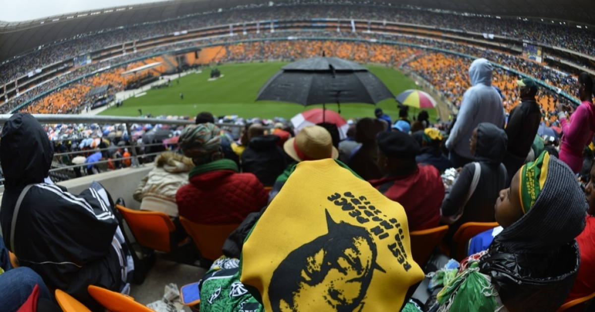 Mourners attend the memorial service of former South African President Nelson Mandela at the FNB Stadium (Soccer City) in Johannesburg on Dec. 10, 2013.</p>