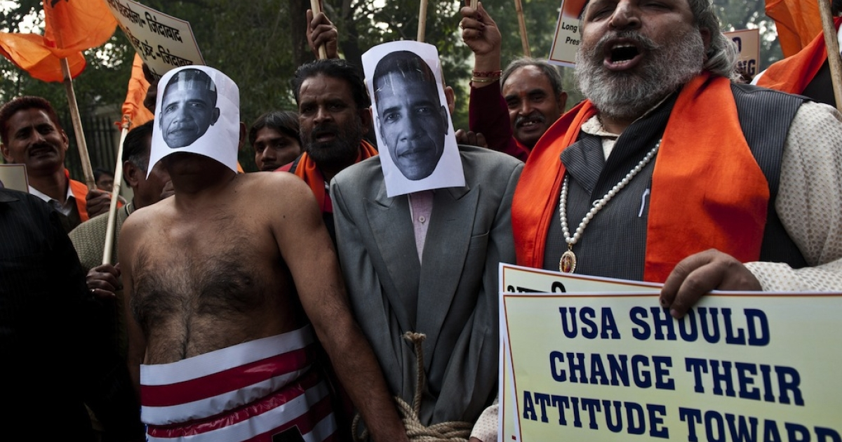 Right-wing Indian Hindu activists dressed as US President Barack Obama take part in a protest near the US Embassy in New Delhi on December 18, 2013. India vowed Wednesday to bring one of its diplomats home at any price after her arrest in New York, as she told how she broke down in tears after being stripped and cavity-searched.</p>