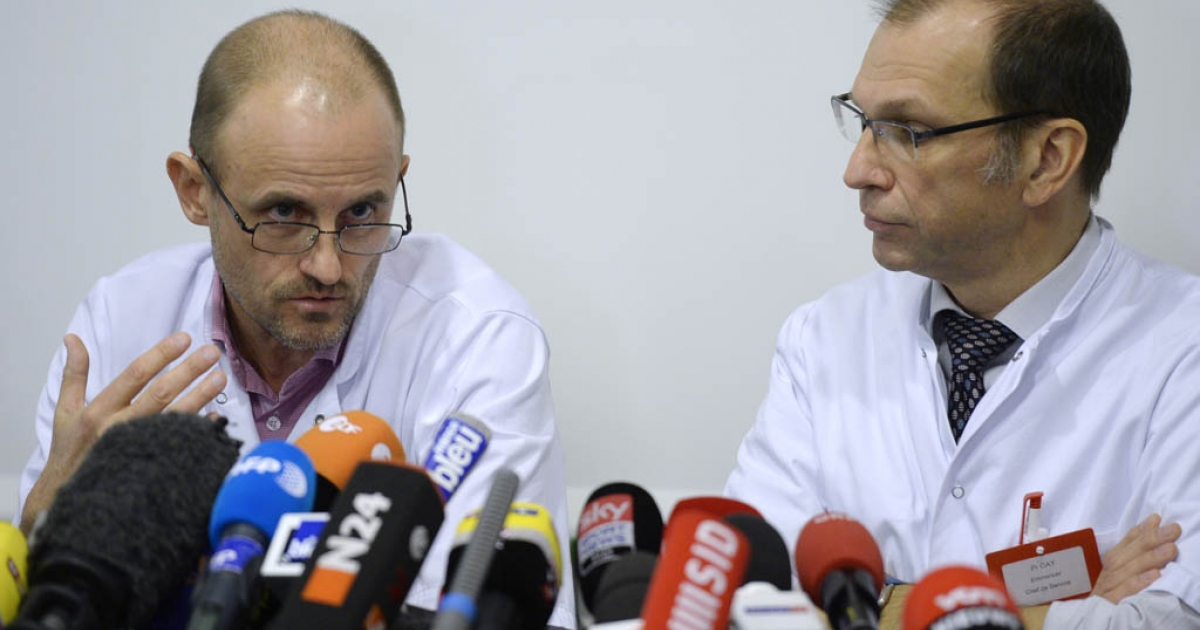 Neurosurgeon professor Jean-Francois Payen speaks next to neurosurgeon chief Emmanuel Gay during a press conference about Michael Schumacher's health condition on December 31, 2013 at the Centre Hospitalier Universitaire hospital in Grenoble, French Alps. Doctors treating Michael Schumacher said Tuesday the Formula One legend has undergone a second operation following his life-threatening ski accident but warned he is