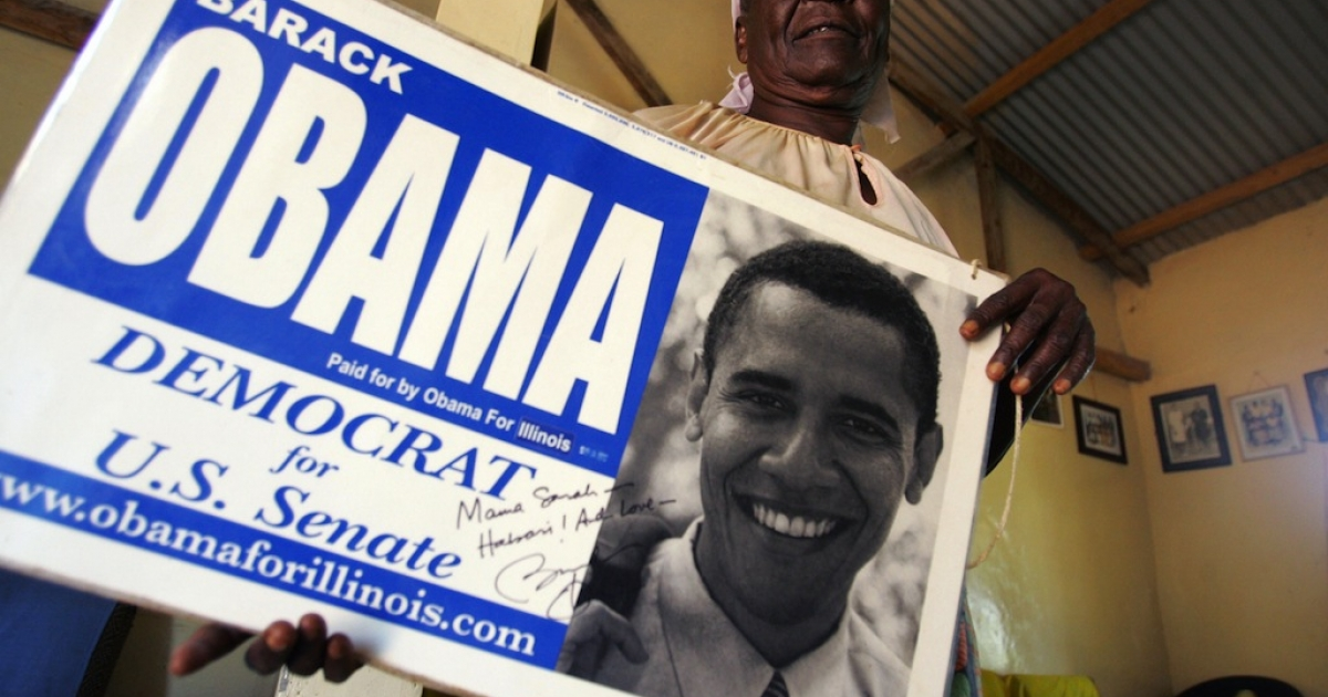 Grandmother of US Presidential candidate and US Senator Barrack Obama, Sarah Obama Onyango holds a senate election placard promoting Obama at her home in the Kogelo Community in western Kenya 04 February 2008.</p>