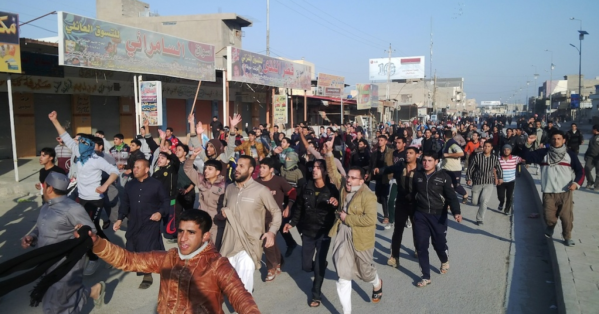 Iraqis march during a protest against the arrest of MP Ahmed al-Alwani in Ramadi, west of Baghdad, on December 28, 2013.</p>