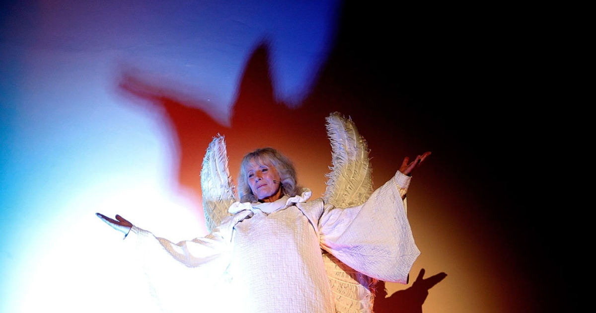 Angel Gabriel, played by Kathy Longbottom, appears to Mary during a living Nativity performance on December 19, 2013 in London, England.</p>