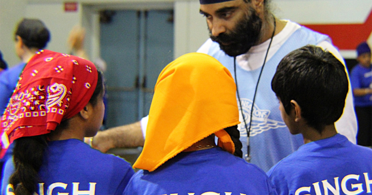 Camp participants gather around a counselor at the second annual Sikh Sensations Basketball Camp in Los Angeles.</p>