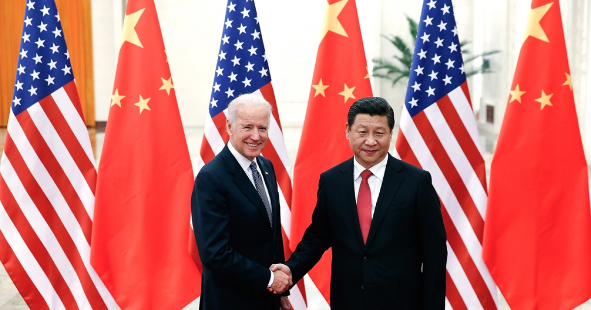 Chinese President Xi Jinping shake hands with US Vice President Joe Biden inside the Great Hall of the People on December 4, 2013 in Beijing, China.</p>