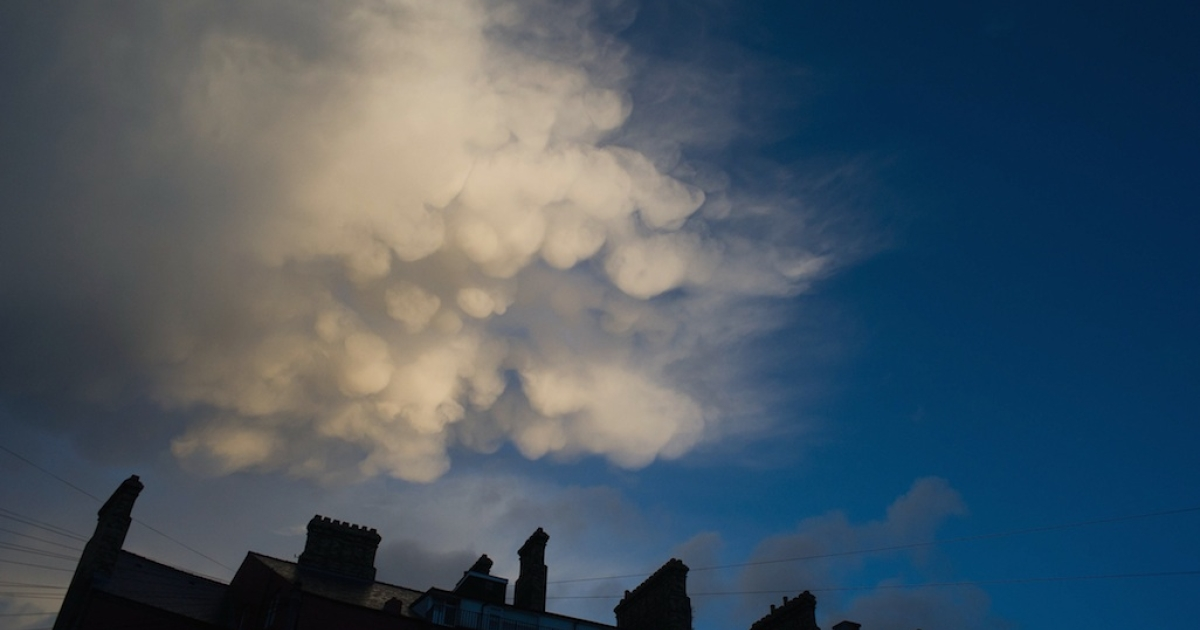 Unusual cloud formations appear over houses on October 27, 2013 in Saltburn, United Kingdom.</p>