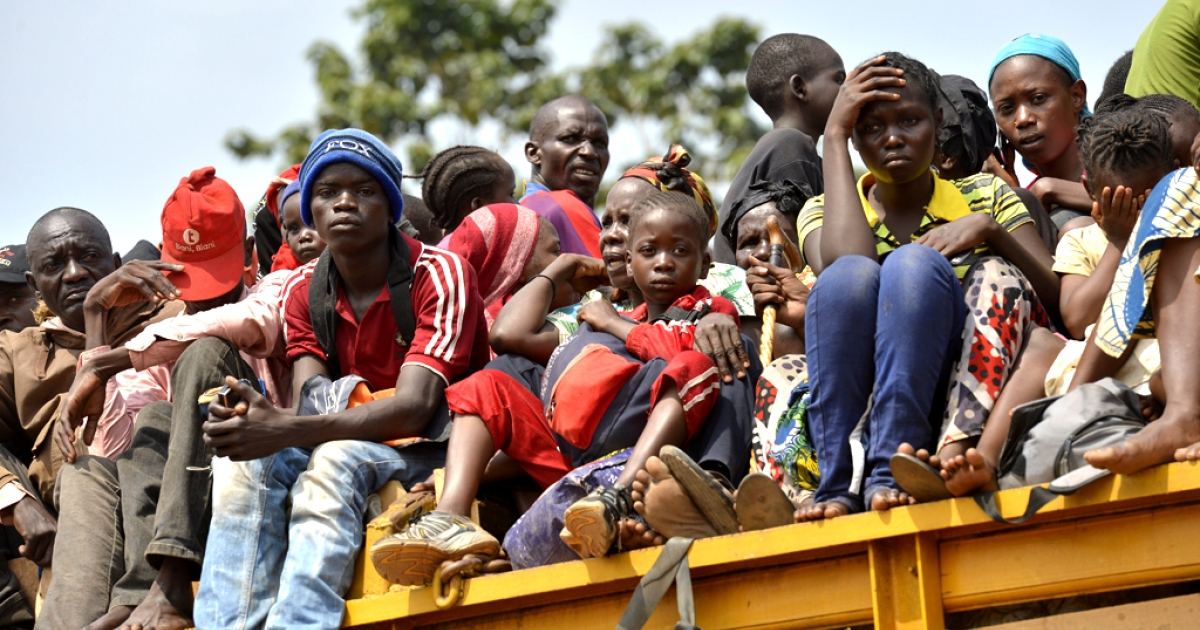 Chadian civilians sit in the back of trucks in the 4th district of the Central African Republic's capital Bangui as they flee the city on December 28, 2013.</p>