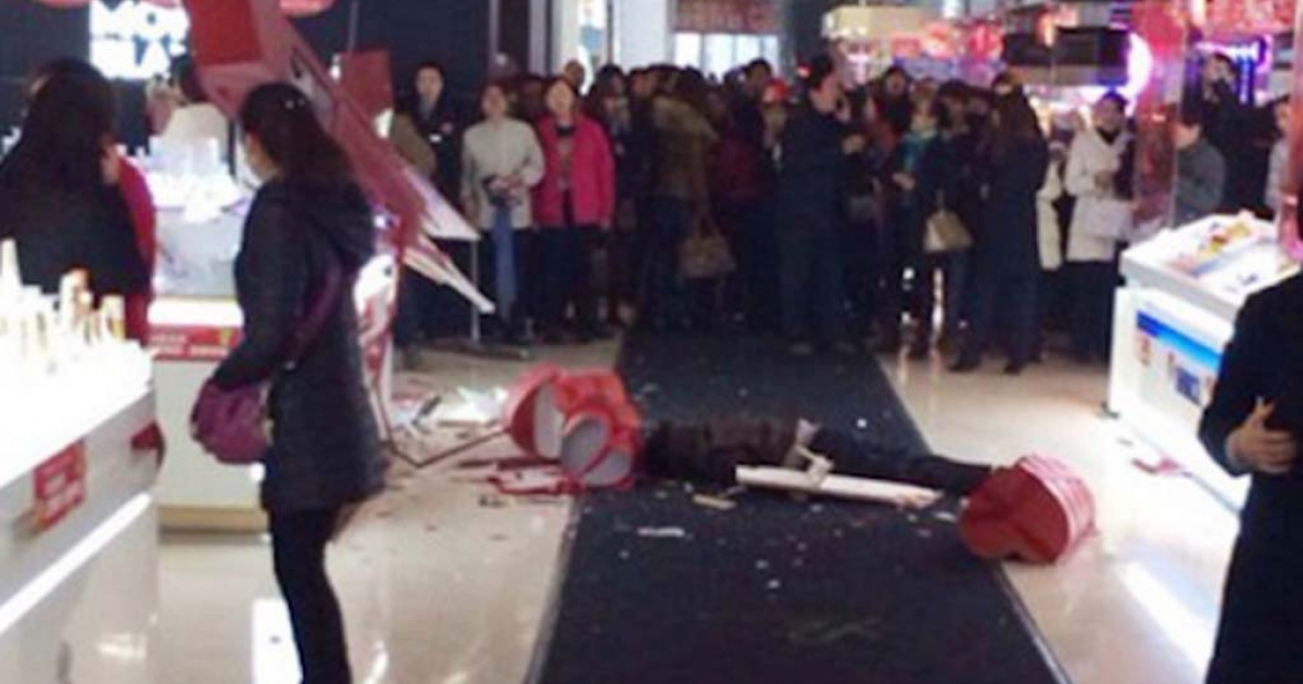 A Chinese man jumped seven stories to his death after eyewitnesses said his girlfriend refused to stop shopping.</p>