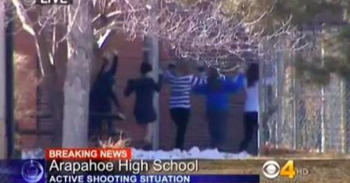 Students stream out of Arapahoe High School in suburban Denver, arms raised, following reports of a shooting in the cafeteria on Dec. 13, 2013. The shooting comes one day before the one-year anniversary of the Newtown massacre.</p>