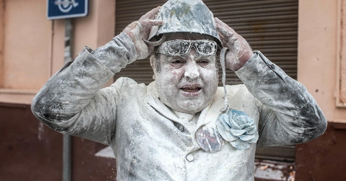 Revellers take part in the battle of 'Enfarinats,' a flour fight in celebration of the Els Enfarinats Festival on December 28, 2013 in Ibi, Spain. Citizens of Ibi annually celebrate the festival with a battle using flour, eggs and firecrackers. The battle takes place between a group of married men called 'Els Enfarinats' that takes the control of the village for one day, pronouncing a whole host of ridiculous laws and fining the citizens that infringe them, and another group called 'La Oposicio,' which tries to restore order. At the end of the day, the money collected from the fines is donated to charitable causes in the village. The festival has been celebrated since 1981 after the town of Ibi recovered the tradition but the origins remain unknown.</p>