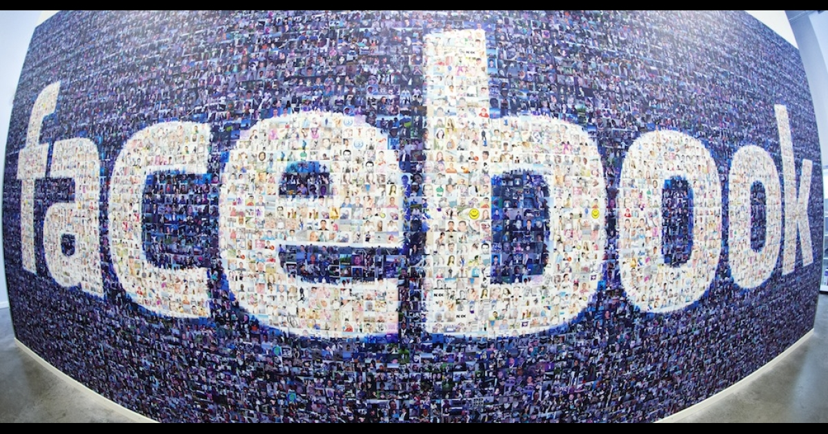 The Facebook logo created from pictures of Facebook users worldwide in the company's Data Center on Nov. 7, 2013.</p>