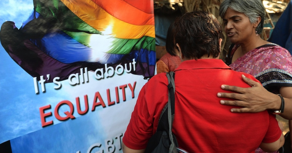 Indian activists console each other during a protest against the Supreme Court ruling reinstating a ban on gay sex, in Mumbai on December 11, 2013. India's Supreme Court reinstated a colonial-era ban on gay sex on that could see homosexuals jailed for up to ten years in a major setback for rights campaigners in the world's biggest democracy.</p>