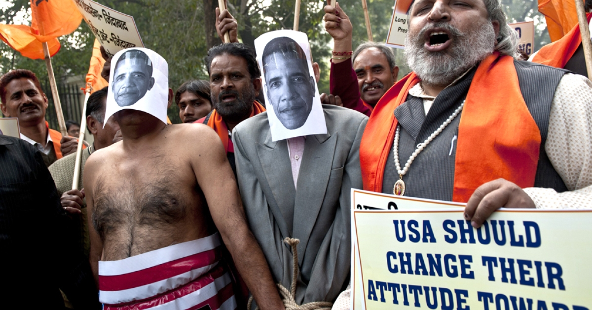 Right-wing Indian Hindu activists dressed as US President Barack Obama take part in a protest near the US Embassy in New Delhi on December 18, 2013. India vowed Wednesday to bring one of its diplomats home at any price after her arrest in New York.</p>