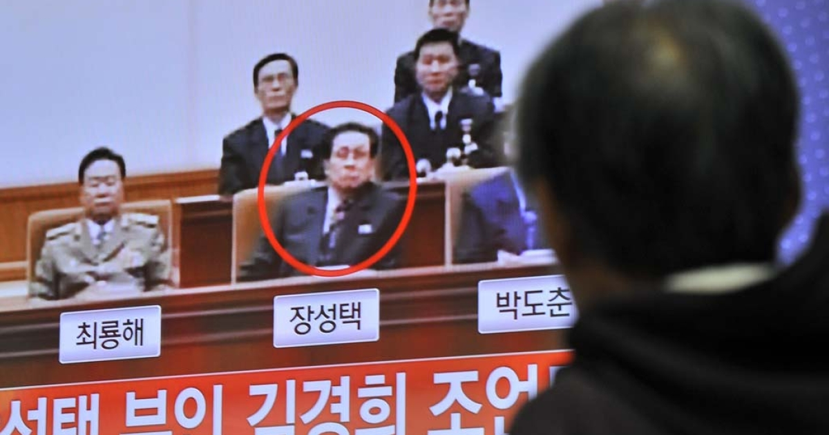 A South Korean man watches TV news about the alleged dismissal of Jang Song Thaek, North Korean leader Kim Jong-Un's uncle, at a railway station in Seoul on Dec. 3, 2013.</p>