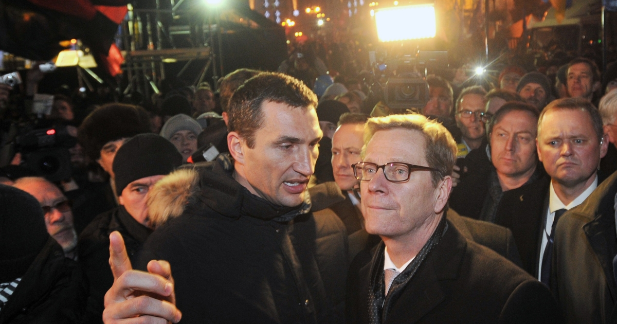 German Foreign Minister Guido Westerwelle (R) with Ukrainian boxing champion Wladimir Klitschko, brother of opposition leader Vitali, during an opposition rally in Kiev on Wednesday. Westerwelle said the gates of Europe are still open for Ukraine.</p>