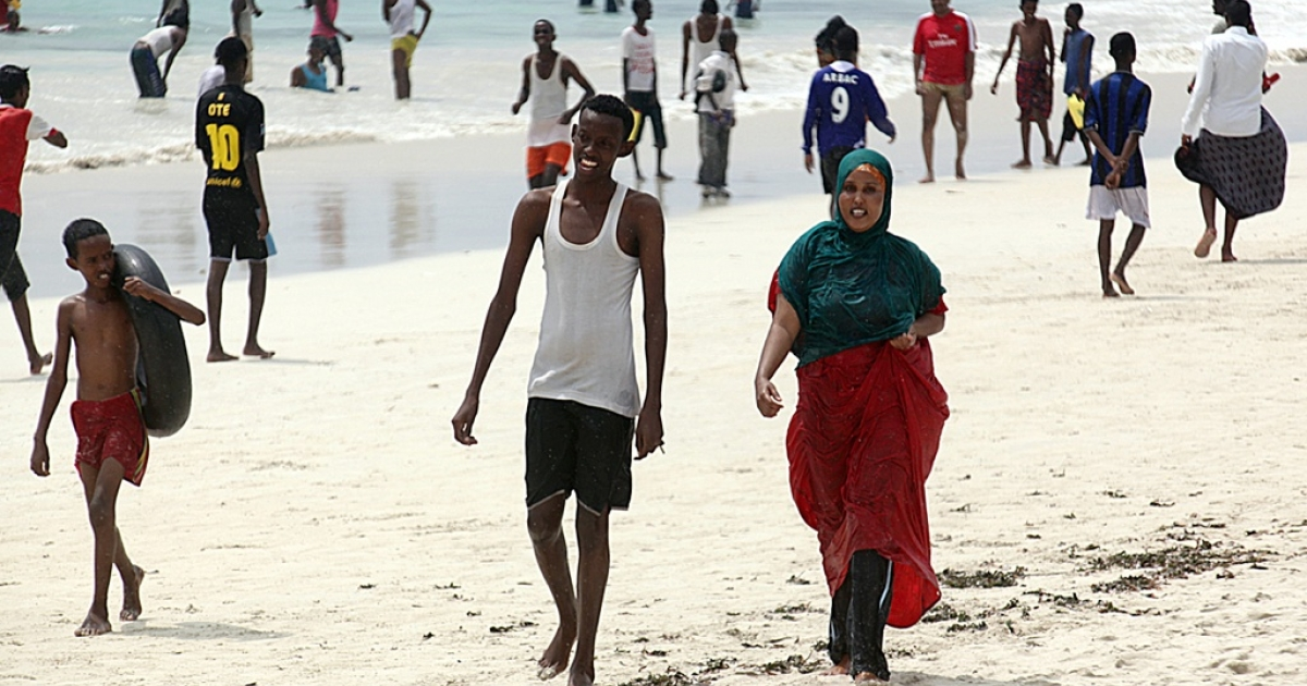 Somali youths walk and play along the beach on the outskirts of Mogadishu on Nov. 18, 2011.</p>