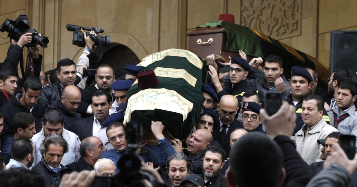 The coffin of former Lebanese finance minister Mohammad Shatah is carried out of a mosque during their funeral in downtown Beirut, on Dec. 29, 2013.</p>