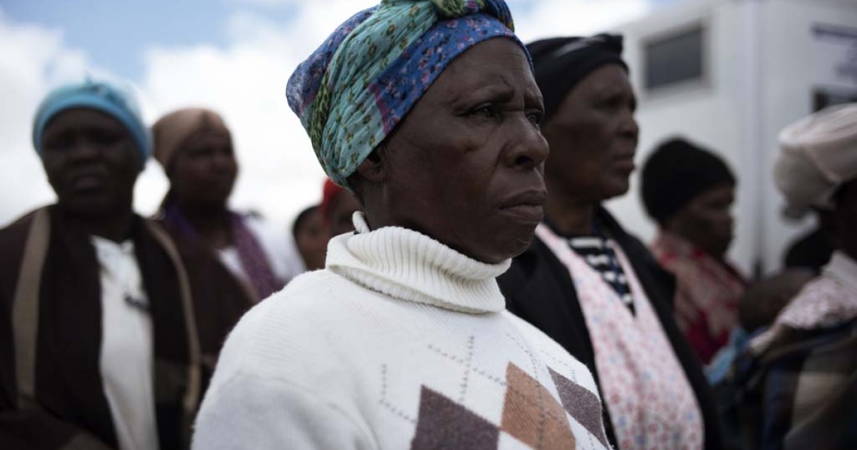 Women look from a hilltop opposite the location of South African former president Nelson Mandela funeral ceremony in Qunu on Dec. 15, 2013.</p>