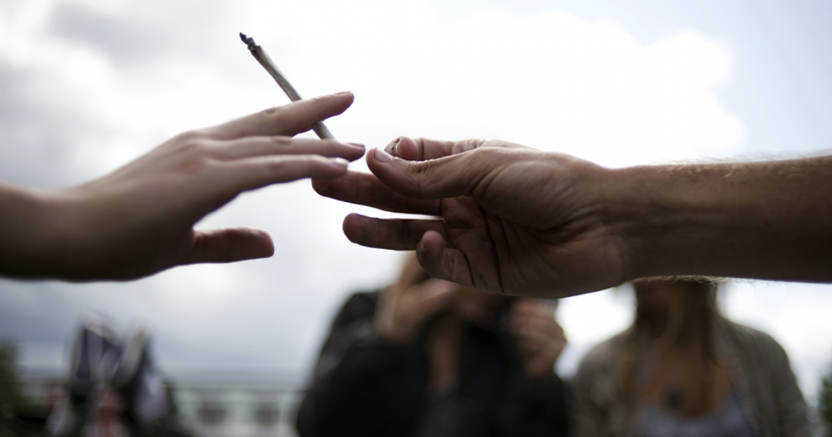 Passing the joint.</p>