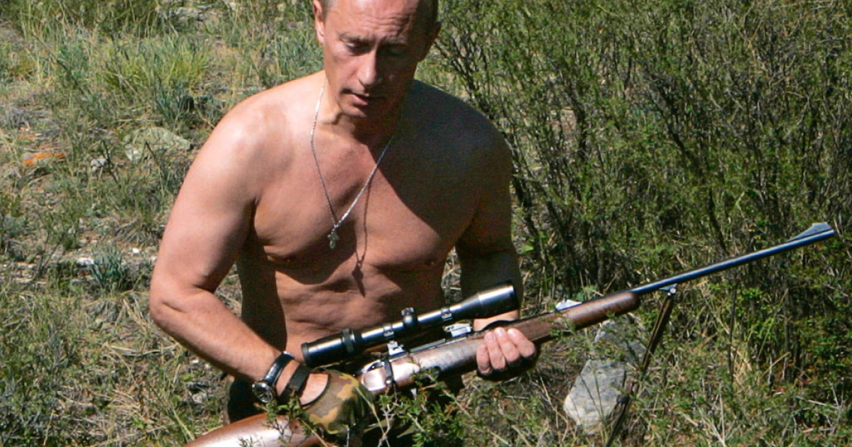 Russian President Vladimir Putin carries a hunting rifle in the Republic of Tuva, Aug. 15, 2007.</p>
