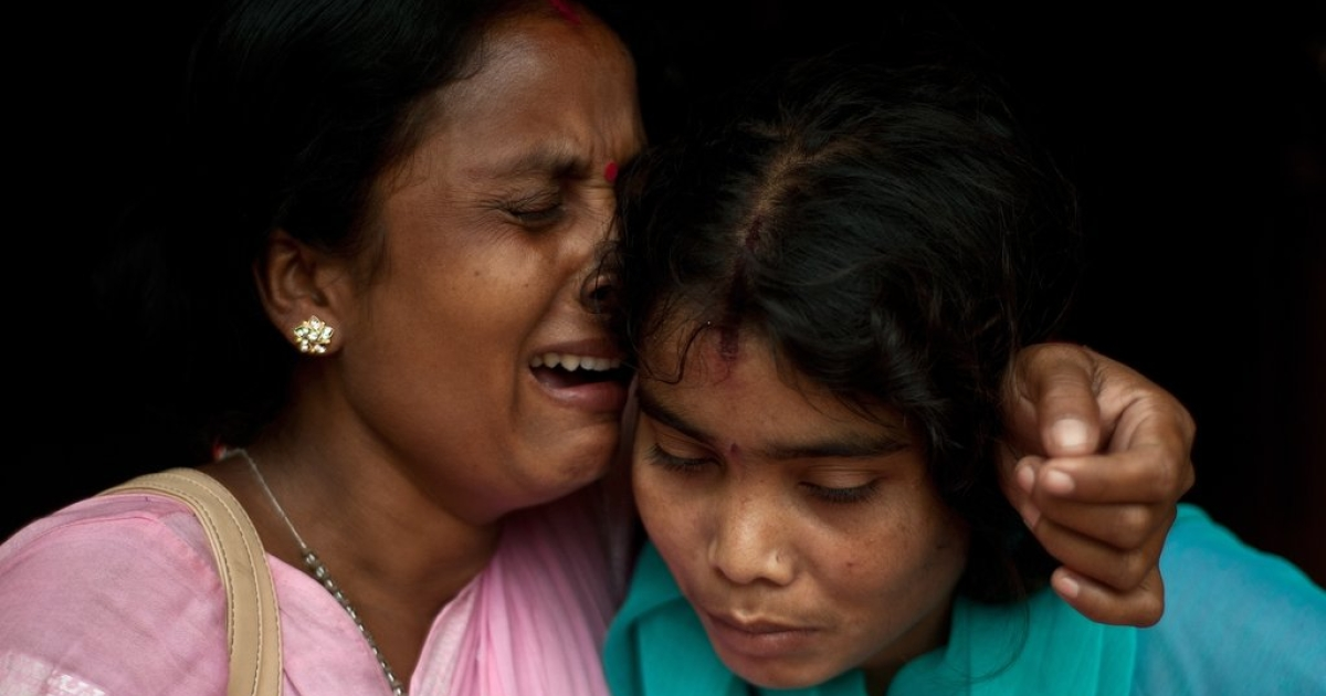 An alleged Indian human trafficking victim (R) is hugged by her sister after being rescued from a village in Karnal around 100 kilometers from New Delhi on September 16, 2013. In India, mostly women are trafficked or tricked into different forms of slavery ranging from domestic service to prostitution. Desperately poor parents also sell their children who are then forced into begging rackets and manual labor. According to the National Crime Records Bureau, some 38,000 children were kidnapped last year in India compared with 33,000 the year before. Child rights groups say the actual number is probably much higher.</p>