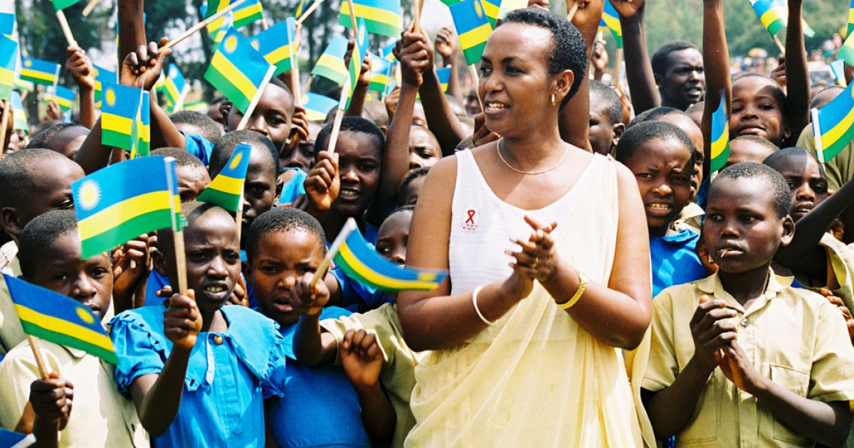 The late Aloisea Inyumba, then gender minister, stands in a Rwandan village. She placed 500,000 orphans with families after the genocide, ignoring Hutu and Tutsi distinctions.</p>