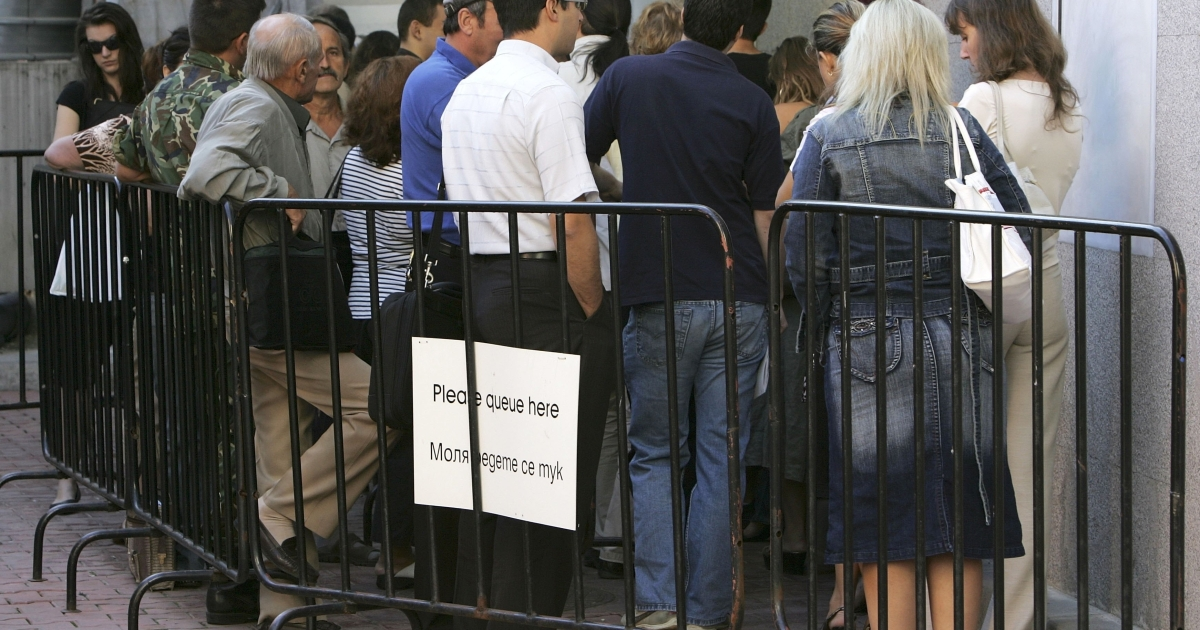 Bulgarians line up outside the British Embassy in Sofia.</p>
