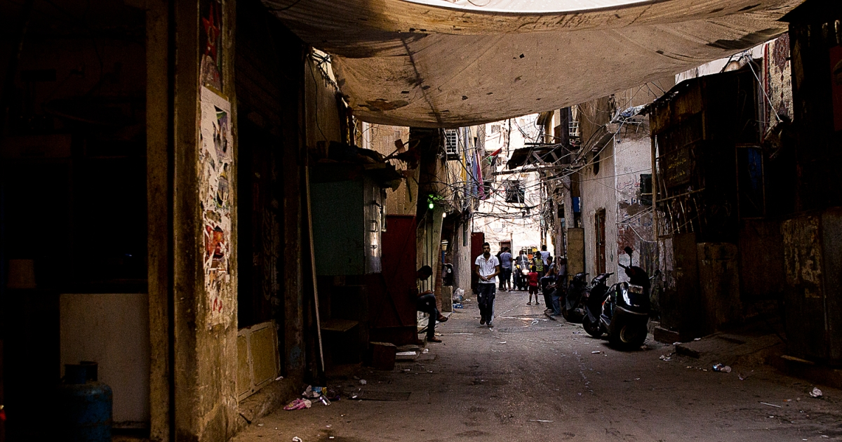 A man walks through the Shatila refugee camp in southern Beirut, Lebanon.</p>