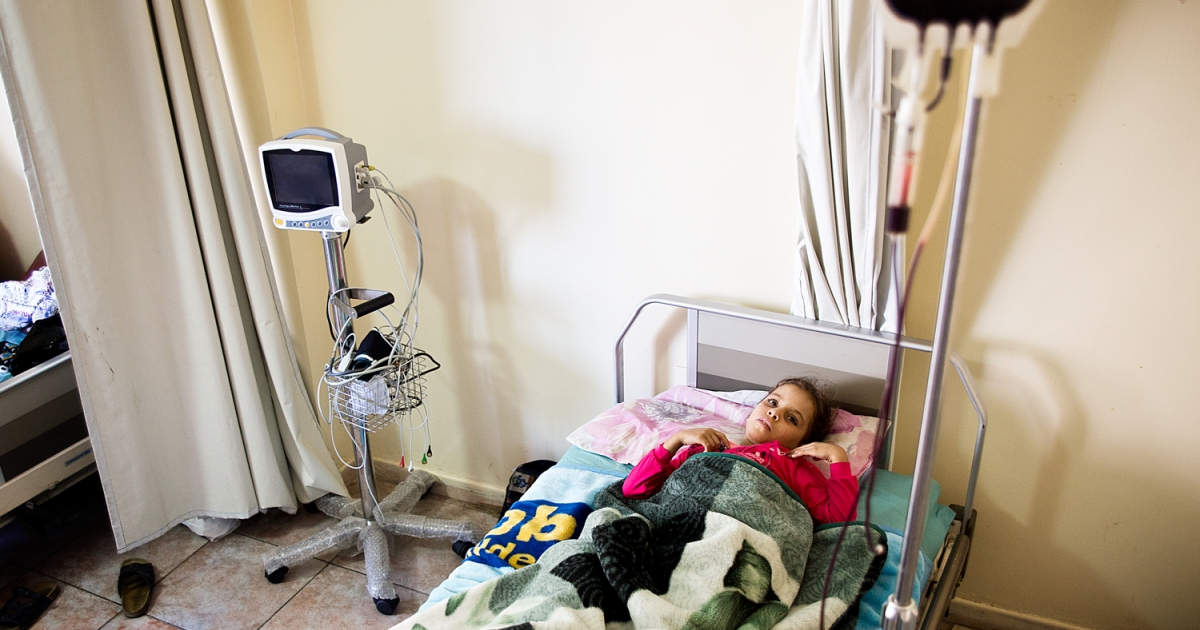 A Syrian girl receives a blood transfusion at a hospital in Tripoli, Lebanon. The country's healthcare system has been overwhelmed by the needs of refugees.</p>