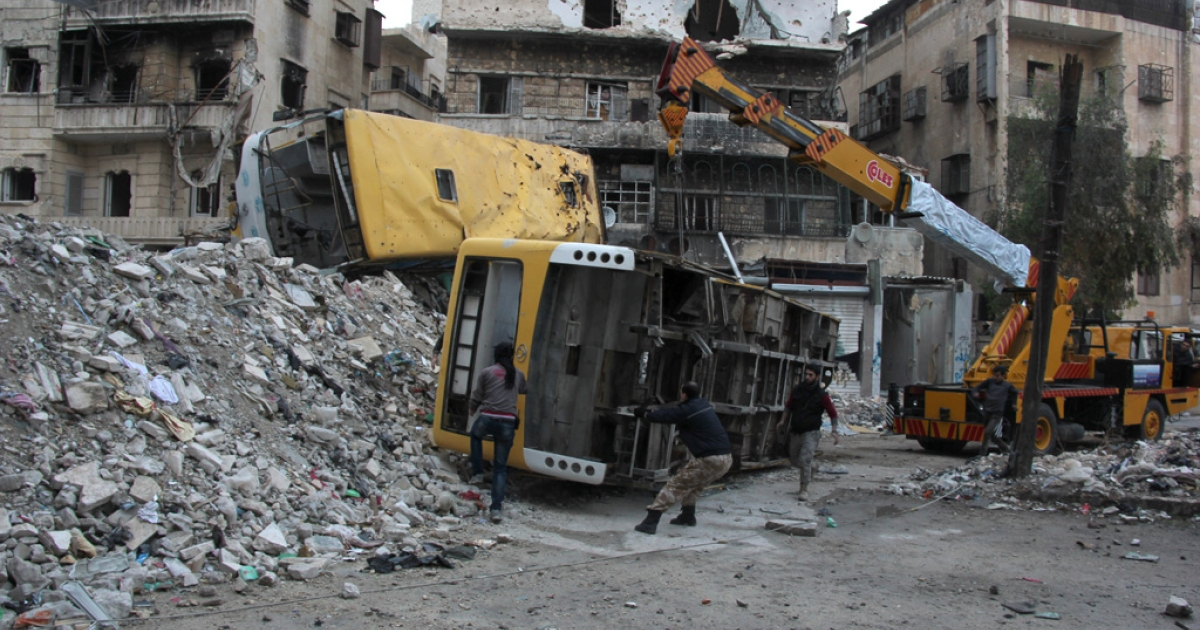 Rebel fighters fortify a barricade with destroyed buses in the Salah al-Din neighbourhood of the northern Syrian city of Aleppo, December 4, 2013. Nearly 126,000 people have been killed in the Syrian conflict, according to the Observatory, and the UN human rights chief said on December 2, that there was evidence of both war crimes and crimes against humanity in the conflict.</p>