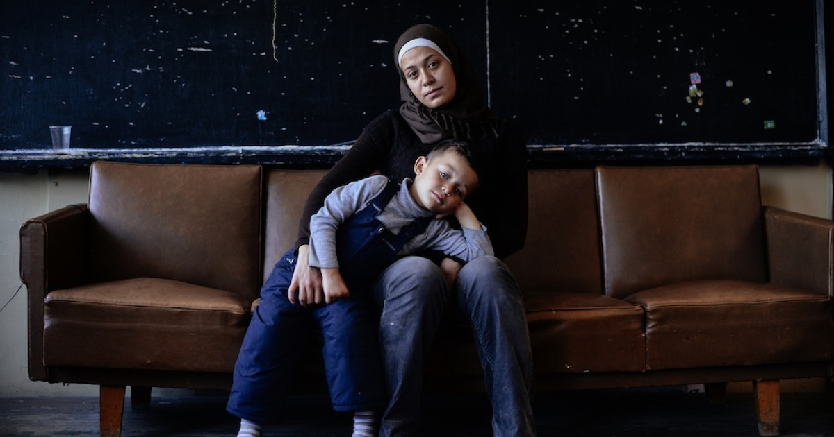 A Syrian woman poses for a photo with her four-year-old son at the Vrazhdebna refugee centre in the Bulgarian capital of Sofia on Oct. 24, 2013.</p>