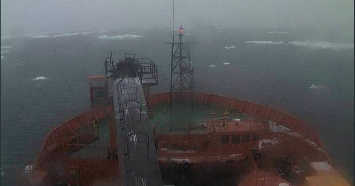 The view from the Australian icebreaker ship Aurora Australis at about 8 p.m. on Dec. 29, 2013, as it neared the Russian research vessel MV Akademik Shokalskiy, which has been trapped by thick ice off eastern Antarctica since Christmas Eve.</p>