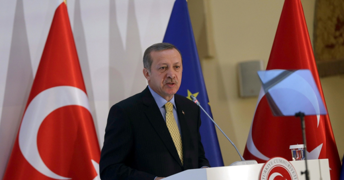 Turkey's Prime Minister Recep Tayyip Erdogan delivers a speech during the Turkey-EU readmission agreement signing ceremony in Ankara on December 16, 2013.</p>