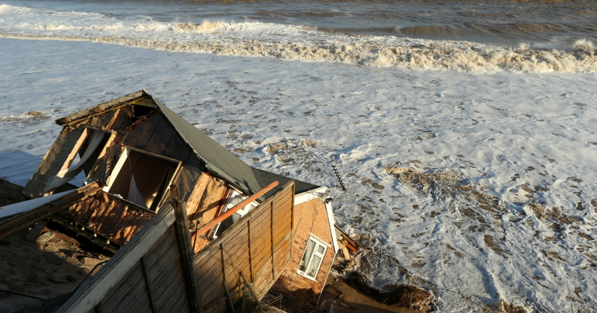 The scene where properties have fallen into the sea due to the cliff collapsing on December 6, 2013 in Hemsby, England. Thousands of people were evacuated from their homes as a deadly winter storm and the highest tidal surge in 60 years hit east coast towns overnight, causing flooding and damage in many areas.</p>