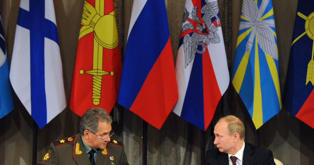 Russian Defence Minister Sergei Shoigu, left, and President Vladimir Putin speak during a defence ministry meeting in Moscow on December 10, 2013. Putin ordered today Russia's military to step up its presence in the Arctic after Canada signalled its intention to claim the North Pole and surrounding waters.</p>