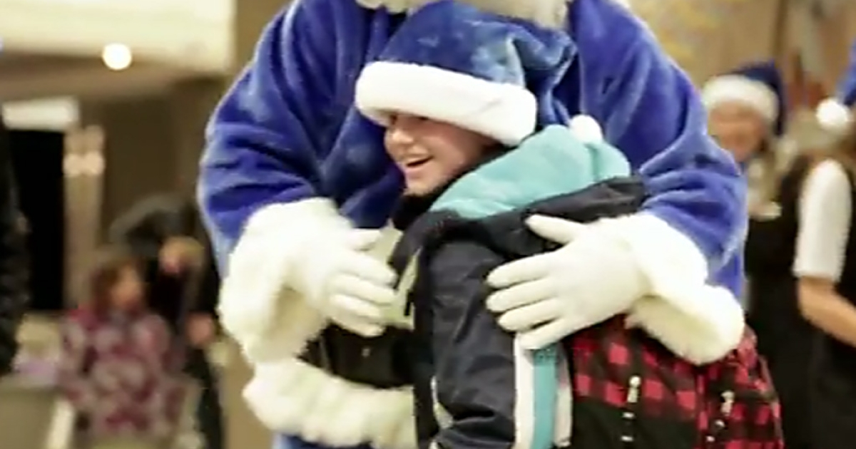 A young boy hugs the WestJet Santa after receiving a tablet computer for Christmas during the Canadian airline's viral marketing campaign filmed at Calgary airport.</p>