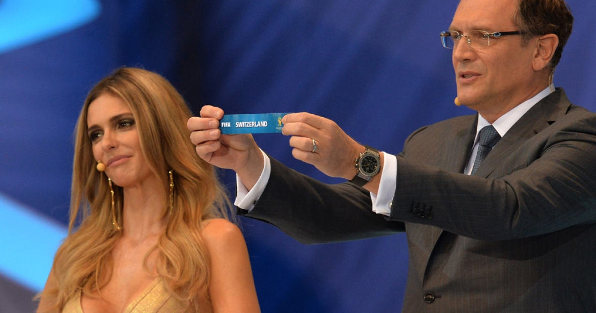 FIFA Secretary General Jerome Valcke shows the name of Switzerland next to presenter Fernanda Lima during the final draw of the groups for the Brazil 2014 FIFA World Cup on December 6, 2013 in , in Costa do Sauipe.</p>