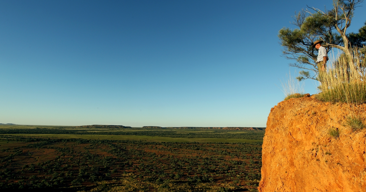 Station owner Charlie Phillott looks out from a cliff on his land in Winton, outback Australia.</p>
